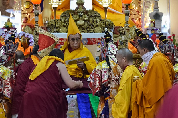 The Dalai Lama receives an offering during a long life prayer ceremony in Dharamsala, India, June 21, 2015. RFA