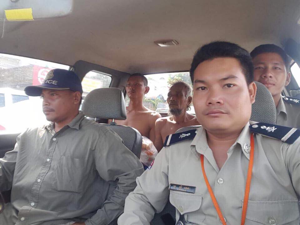 Police escort the missing men in Siem Reap province. Supplied